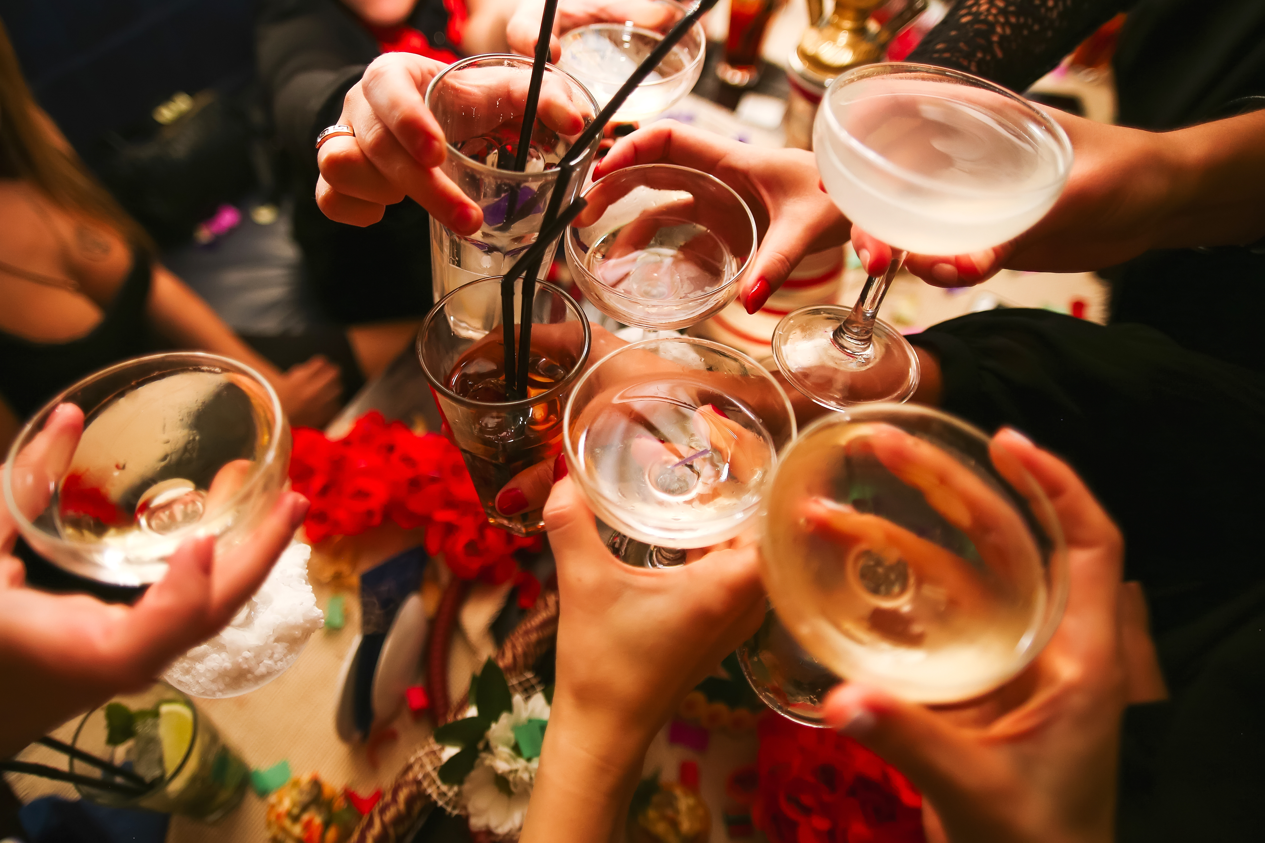 Clinking glasses with alcohol and toasting party