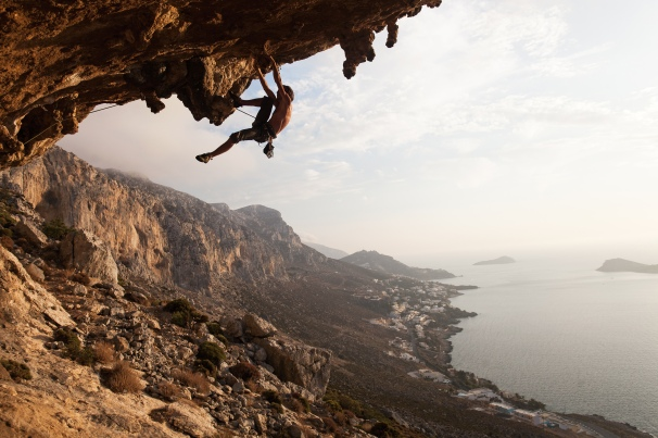 Rock climber at sunset Kalymnos Island Greece